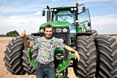 Farmer with tractor showing OK sign — Stock Photo