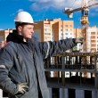 Construction worker at building site - Foto Stock