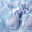 Blue baby booties - Stock Photo