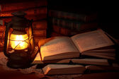 Old oil lamp and old books — Stock Photo