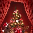 Christmas tree with teddy bear - Stock Photo