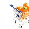 Orange paprika's in shopping trolley — Stock Photo #7125169