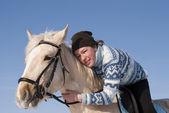 Young girl on horseback — Stock Photo