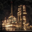 Stock Photo: Round the clock running an oil refinery.