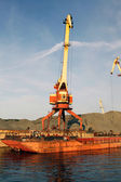 Port bulk crane and barge — Stock Photo