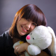Smiling young woman with plush rabbit — Stock Photo #7064548