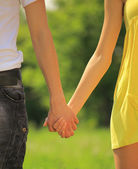 Boy and girl holding hands — Stock Photo