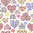 Stock Vector: Seamless background with hearts