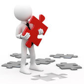 Man with a red puzzle piece in hand — Stock Photo