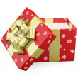 Stock Photo: Red Christmas gift open with gold ribbon