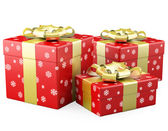 Three red Christmas gifts with a gold ribbon — Stock Photo