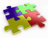 Cuatro rompecabezas de piezas de distintos colores, rojo, azul, amarillo y verde — Foto de Stock