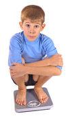 Adolescente em balanças de chão — Foto Stock