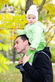 Small beautiful girl in green suit with father — Stock Photo