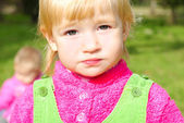Portrait small girl on green herb by autumn — Stock Photo
