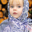 Stock Photo: Portrait of the small beautiful girl in a dark blue scarf