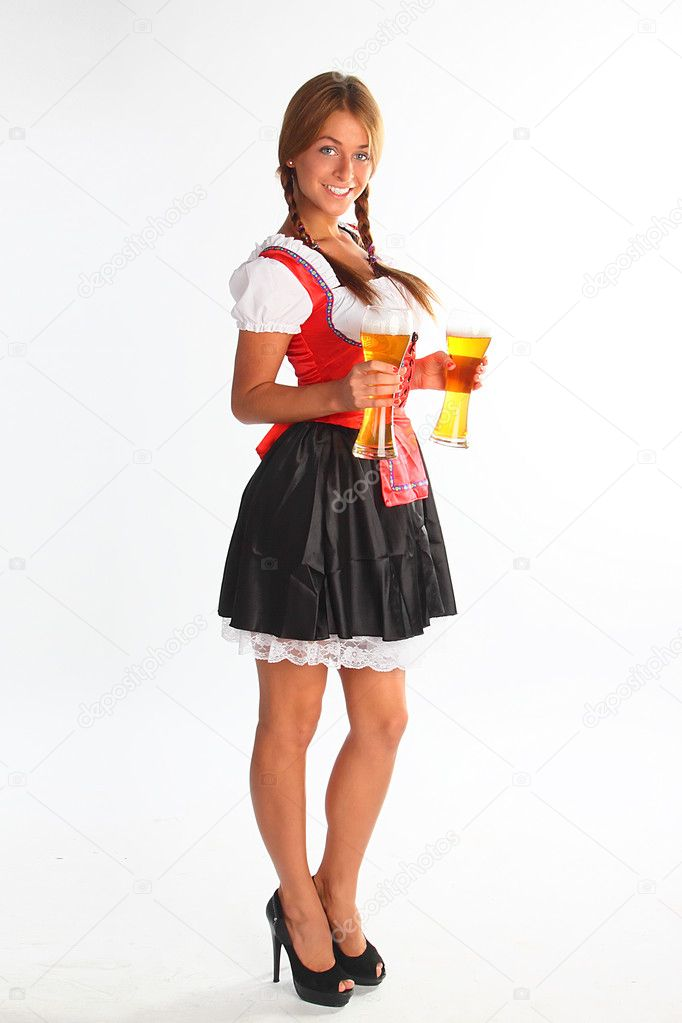 The girl in a traditional Bavarian dress with full glasses of beer in hands — Stock Photo #6869855
