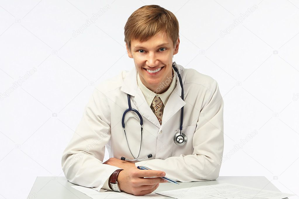 The young doctor in a white dressing gown  Stock Photo #6896493