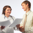 The woman the doctor accepts the adult man — Stock Photo