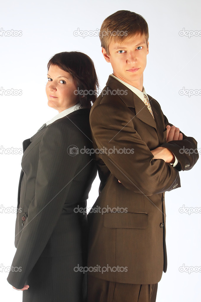 The man and the woman in strict business suits  Stock Photo #6936971