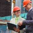 Stock Photo: Two businessmen on building