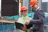 Two businessmen on building — Stock Photo