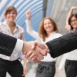 Hand shake of two businessmen - Stock Photo