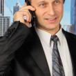 Stock Photo: Businessman is speaking on the mobile phone
