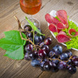 Stock Photo: Pepper salami and bunches of grapes