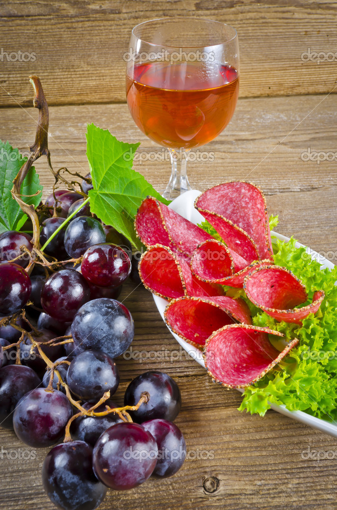 Best Pepper salami and bunches of grapes  Stock Photo #6819956
