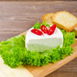 Foto Stock: Curd (Polish Twarozek) with tomatoes