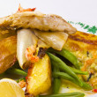Roasted Dorade with seafood and French beans — Stock Photo