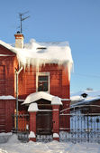 Icicles on the cottage. — Stock Photo