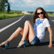 Young girl on the road — Stock Photo