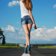 Young girl on the road — Stock Photo #7179443