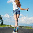 Young girl on the road — Stock Photo #7179445