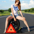 Young girl on the road car problem — Stock Photo #7179457