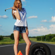 Young girl on the road car problem — Stock Photo #7179493