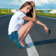 图库照片: Young girl on the road