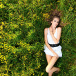 Young girl lying on meadow — Stock Photo #7179565