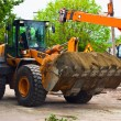 Excavator for road works — Stock Photo #7179661