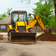 Tractor digging a trench — Stock Photo #7179672