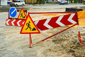 Detour signs next to the road repair — Stock Photo