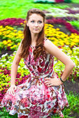 Young girl on the lawn color — Stock Photo