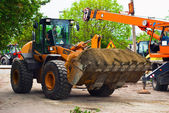 Excavator for road works — Stock Photo