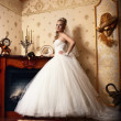 Beautiful young bride stands in the antique interior — Stock Photo #7180252