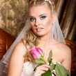 Stock Photo: Beautiful young bride with flower