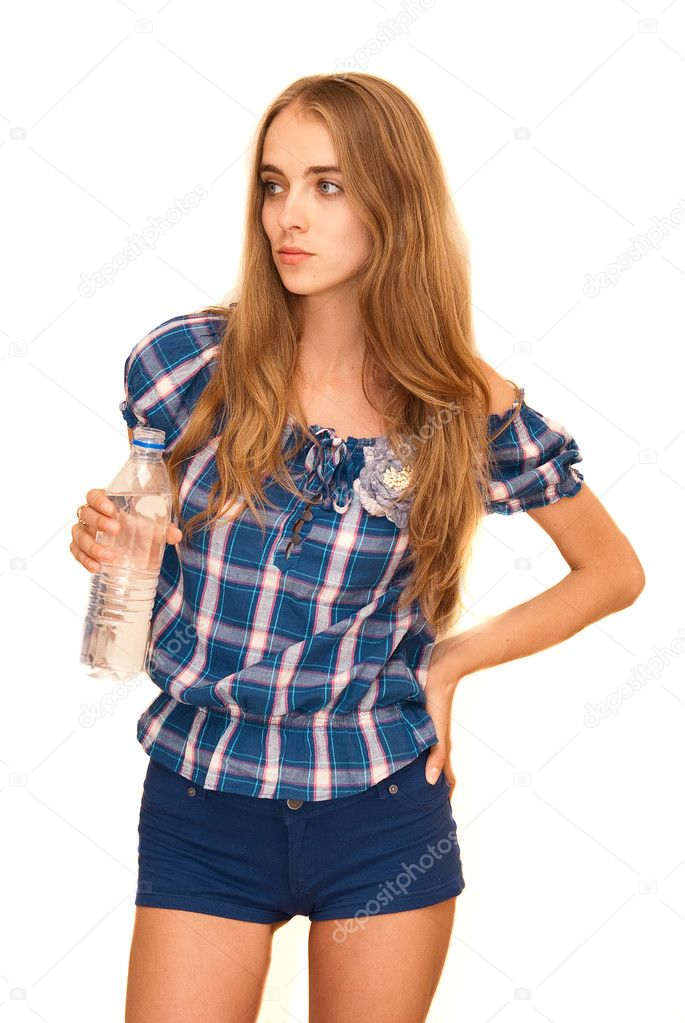 Portrait of young happy smiling woman holding bottle of water, isolated on white background — Stock Photo #7180019