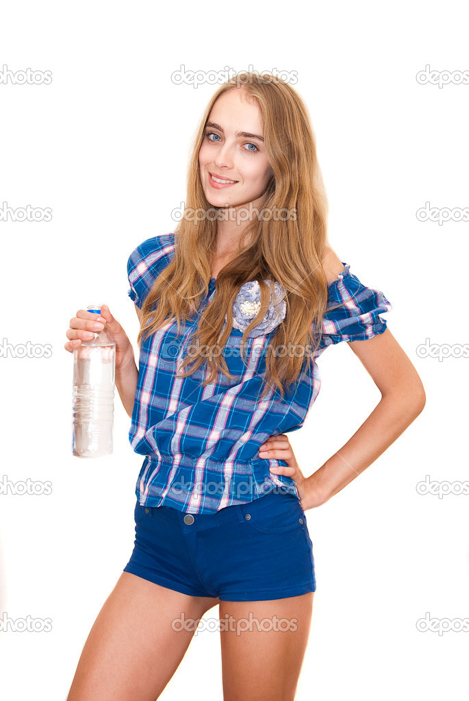 Portrait of young happy smiling woman holding bottle of water, isolated on white background — Stock Photo #7180030