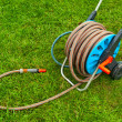Stock Photo: Hose for watering garden on green grass